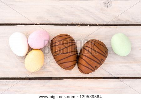 Easter Candy Eggs On A Wooden Table