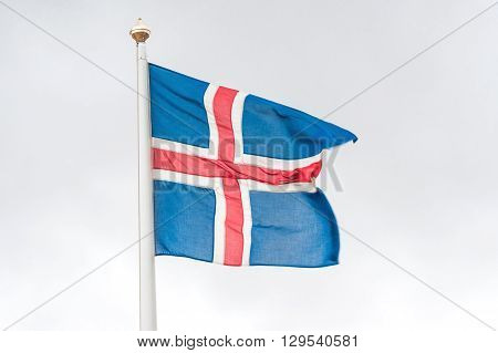 Iceland flag in the wind on a pole