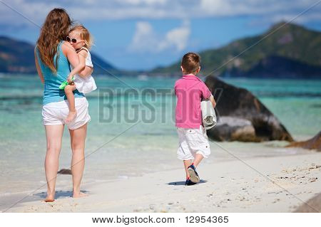 Mother With Kids On Beach Vacation