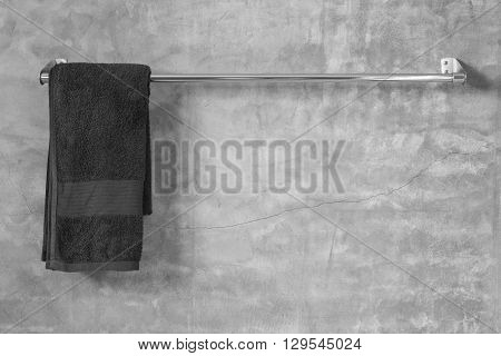 Stainless Steel Towel On Grey Cement Wall With Towel In Bathroom