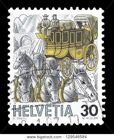 SWITZERLAND - CIRCA 1987 : Cancelled postage stamp printed by Switzerland, that shows Mail coach.
