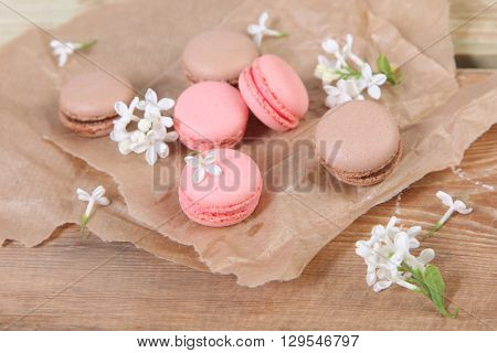 colored sweet  macaroon on wooden background