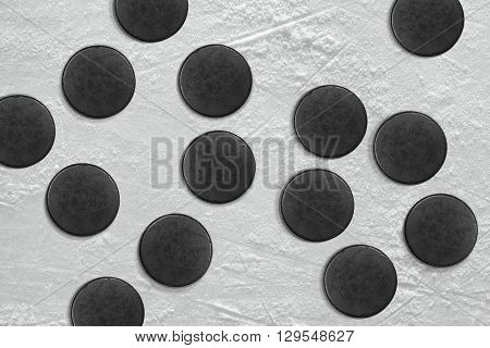 Washers in the ice hockey rink. Hockey texture background