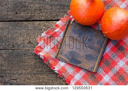 Flat lay two hokkaido pumpkins and board with copyspace on wooden table