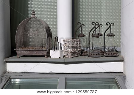 Cage For Birds And Old Lamps