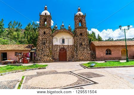 Colonial church in San Pedro village at Raqchi ruins in the Cusco region Peru