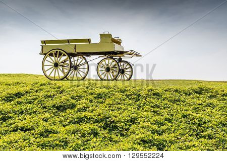 A uncovered wagon retro style in beautiful nature scene farmland.