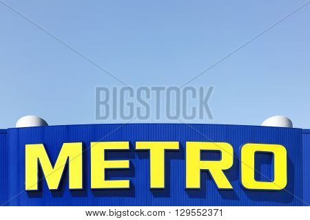 Aalborg, Denmark - May 8, 2016: Metro logo on a facade of a supermarket. Metro cash and carry is a leading international player in self service wholesale trade