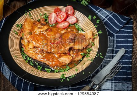 Potato Pancakes With Meat Stew Served On A Plate.