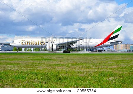 SAINT PETERSBURG RUSSIA - MAY 11 2016. Emirates Airline Boeing 777 aircraft -registration number A6-EBY- rides on the runway after landing in Pulkovo International airport