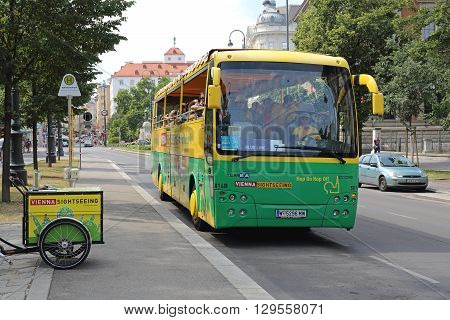 VIENNA AUSTRIA - JULY 12: Vienna Sightseeing Bus For Tourists in Wien on JULY 12 2015. Tourists on Tour in Hop On Hop Off Bus in Vienna Austria.