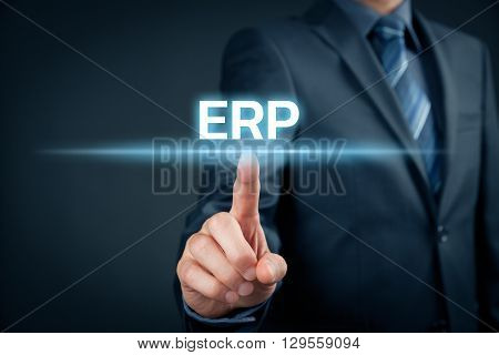 Enterprise resource planning ERP concept. Businessman click on ERP business management software for collect store manage and interpret business data.