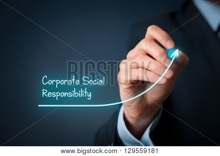 Corporate social responsibility (CSR) concept. Businessman draw improvement graph symbolizing corporate social responsibility improvement.