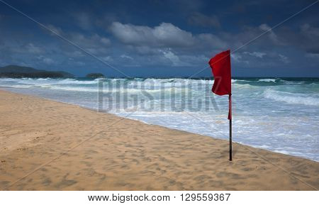 Red flag warning of dangerous seas for swimming on Karon beach, Phuket, Thailand