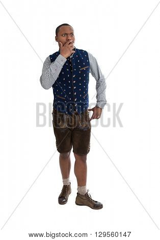 Shocked and wondering isolated colored man wearing traditional bavarian clothes.