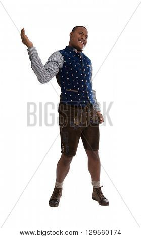 Isolated dark skinned man wearing typical bavarian clothes making promotion for the bavarian beer festival in Munich called Oktoberfest.