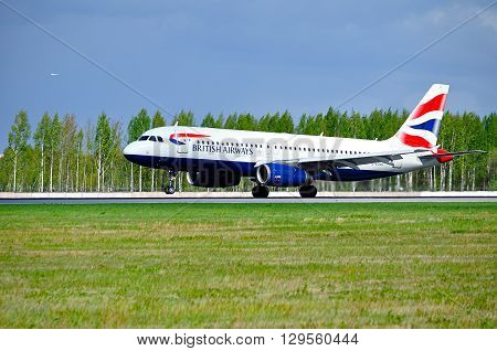 SAINT PETERSBURG RUSSIA - MAY 11 2016. British Airways Airbus A320 aircraft -registration number G-EUUC- rides on the runway after landing in Pulkovo International airport