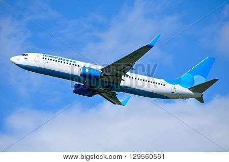 SAINT PETERSBURG RUSSIA - MAY 11 2016. Pobeda Airlines Boeing 737 Next Gen airplane -registration number VQ-BTC- is flying in the sky after departure from Pulkovo International airport