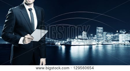 businessman with tablet with passenger liner on water in san francisco