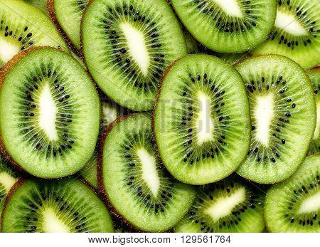 fresh green kiwifruit background. round slices closeup