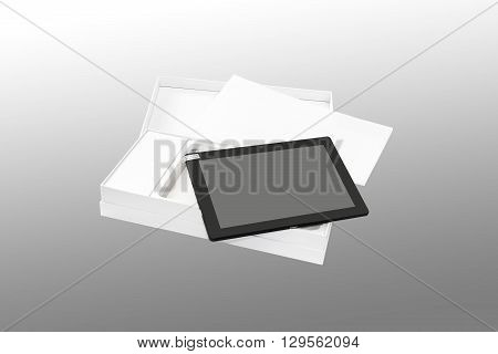Tablet PC in new packaging. Isolated on a gray background.