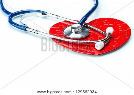 Red Puzzle Heart With Stethoscope Isolated On White Background