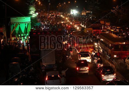 Pune India - September 27 2015: Ganesh festival crowds on last day causing traffic jams in India.