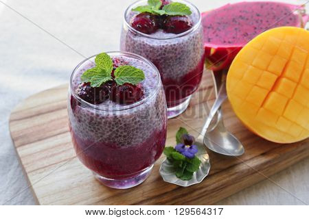 Chia seeds pudding with red dragon fruit and mango