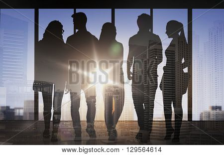 business, education, travel, tourism and people concept - people silhouettes over double exposure office or city airport background