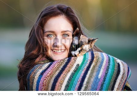 Portrait of the happy smiling girl with sphynx