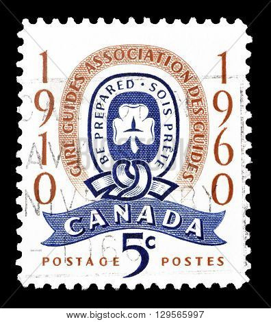 CANADA - CIRCA 1960 : Cancelled postage stamp printed by Canada, that shows Girl guide emblem.