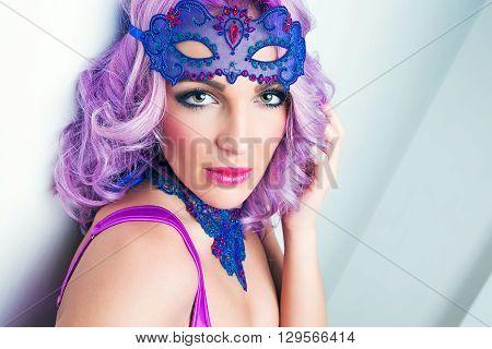 attractive portrait beauty girl in blue mask