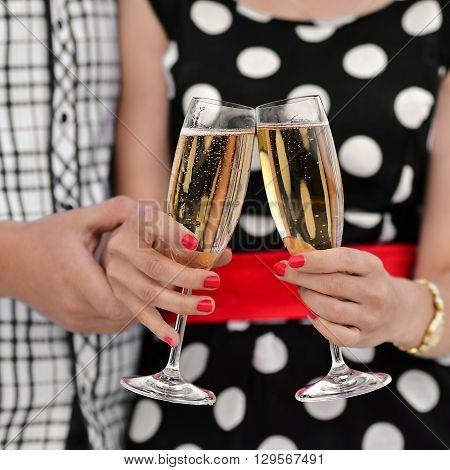 Glasses of champagne. Happy, new, young family. Congratulations. The best wedding, bride and groom, newlywed. Happy couple celebrates anniversary. True, strong, happy relationship. True love. Drink champagne, lucky