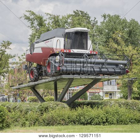 ROSTOV-ON-DON RUSSIA- MAY 11- Combine harvester on a pedestal on May 11 2016 in Rostov-on-Don
