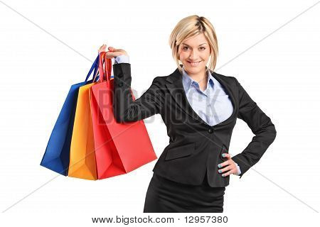 A Happy Blond Female Holding Shopping Bags