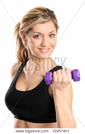 A Young Attractive Woman Exercising With Weights