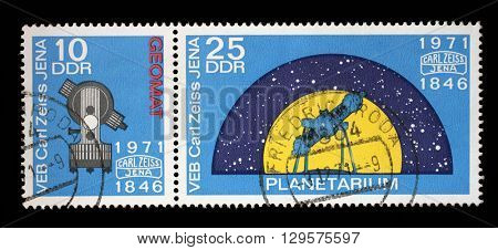 ZAGREB, CROATIA - JULY 03: A stamp printed in GDR from the The 125th Anniversary of Carl Zeiss Jena issue shows Geomat and Planetarium, circa 1971, on July 03, 2012, Zagreb, Croatia