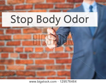 Stop Body Odor - Businessman Hand Holding Sign