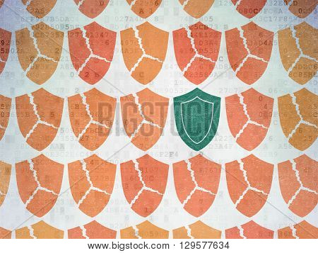 Safety concept: rows of Painted orange broken shield icons around green shield icon on Digital Data Paper background