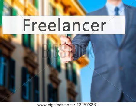 Freelancer - Businessman Hand Holding Sign