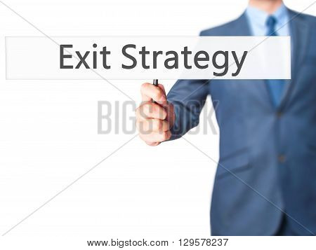 Exit Strategy - Businessman Hand Holding Sign