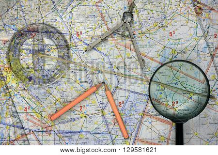 Flying map with planning means magnifying glass pencils ruler caliper
