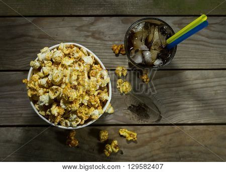 Popcorn and cola on the black background