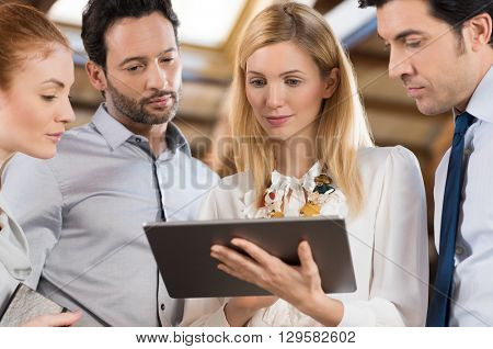 Business people in the office and looking at a digital tablet. Businesswoman holding tablet and shar
