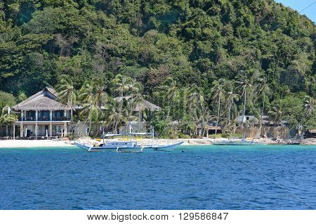 EL NIDO PALAWAN PHILIPPINES - APRIL 5 2016: Outriggers at the Pangulasian Island Resort. In Bacuit Bay the luxury hotel has 42 Villas.