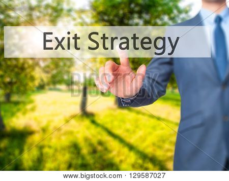 Exit Strategy - Businessman Hand Pressing Button On Touch Screen Interface.