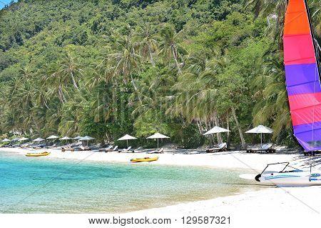 EL NIDO LAGEN ISLAND PHILIPPINES - APRIL 5 2016: Boats and beach at the Pangulasian Island Resort.