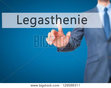 Legasthenie (dyslexia In German) - Businessman Hand Pressing Button On Touch Screen Interface.