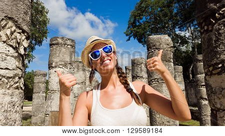 Female Tourist Having Fun At Chichen Itza