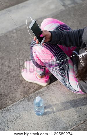 Sporty Woman Taking A Workout Rest For Texting On Smartphone